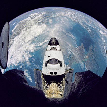 Fish-eye view of the Space Shuttle Atlantis as seen from the Russian Mir space station during the STS-71 mission.